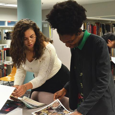 Grad students working in Fashion library