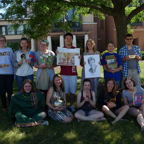 Kent State Language Professor Tatyana Bystrova sits in front of the Honors College with high school students enrolled in last year's STARTALK Summer Foreign Language Academy