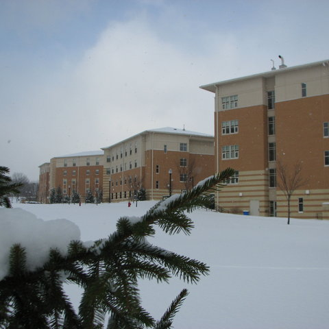 Snow covers the Centennial Court residence halls
