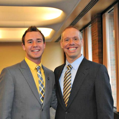 An Honors College advisor and student take a photo at the annual Senior Honors Luncheon.