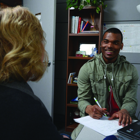 A student meets with an admissions advisor.