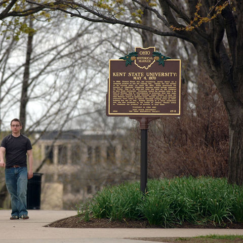 Two students walk by an historical marker near the May 4, 1970 memorial in front of Taylor Hall.