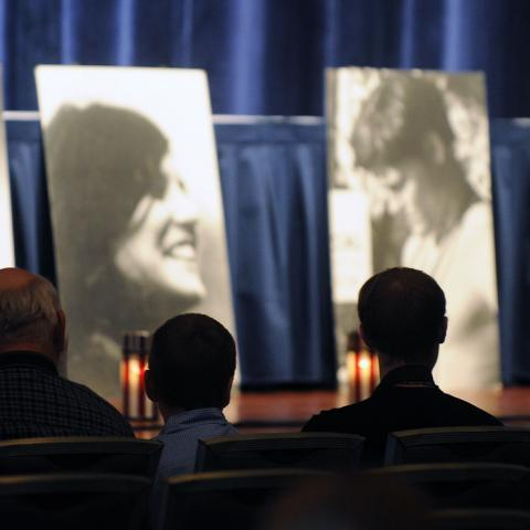 Photos of the 4 students killed during the May 4, 1970 shootings on the campus of Kent State University rest on stage during the 2011 commemoration of the shootings.