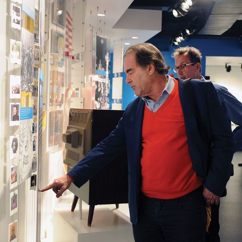 Film director Oliver Stone tours the May 4 Visitor enter on the ground floor of Taylor Hall.