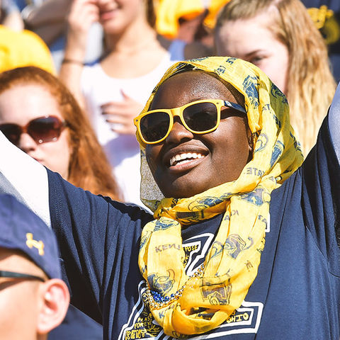Students at the Homecoming football game