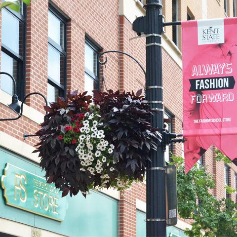 "Fashion School Storefront with ""Always Fashion Forward"" sign"