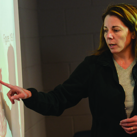 Dr. Mary Russell delivers a biology lecture