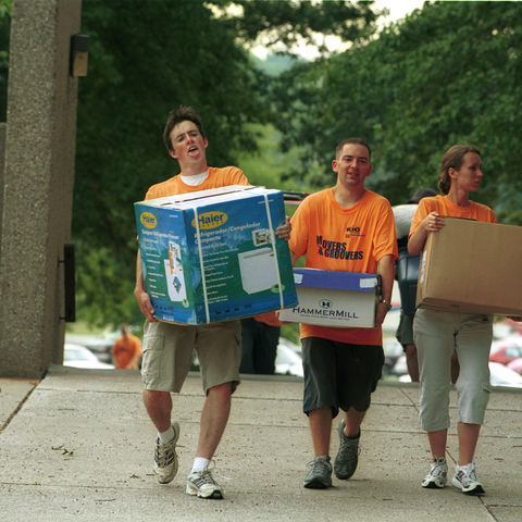 "Students carry boxes into one of the small group residence halls during the 2002 ""Movers and Groovers"" day"