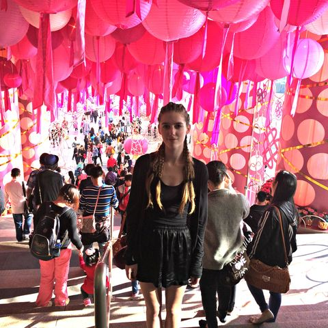 A student poses for a photo during a festival while studying in Asia.