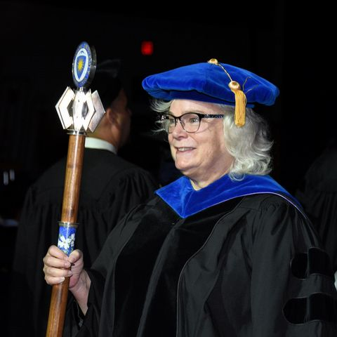 University Macebearer holding the Mace during the Academic Processional