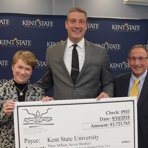 Congressman Tim Ryan, (OH-13), center, stands with Kent State President Beverly Warren, left, and Vice President for Research Paul DiCorleto, right, with a ceremonial check showing $3.7 million in NSF and NIH research grants awarded to KSU this year.