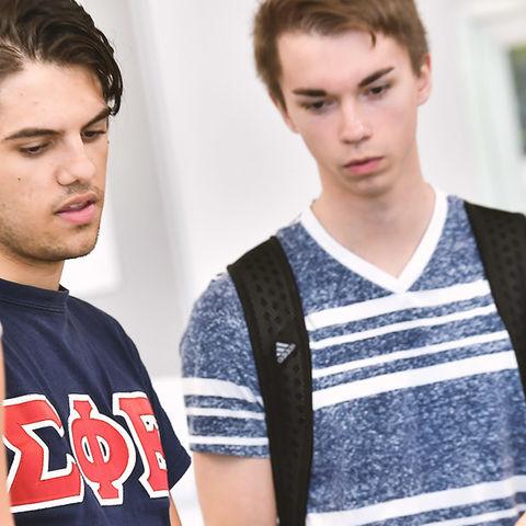 Students looking over homework