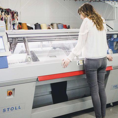 student at Stoll machine in TechStyleLAB