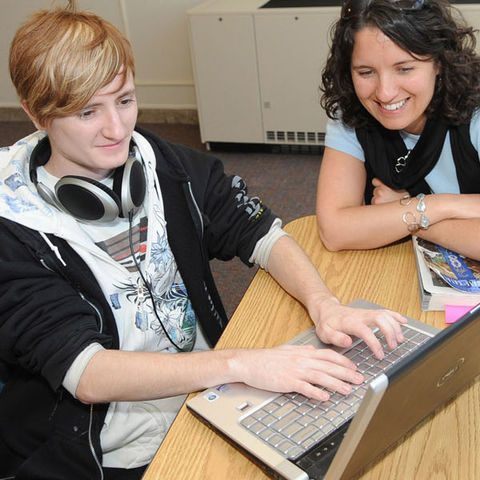 A student gets some laptop tech assistance.