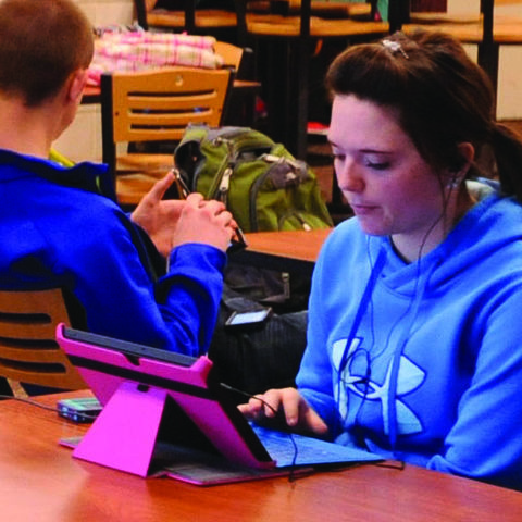 A student checks on financial aid availability in the student union