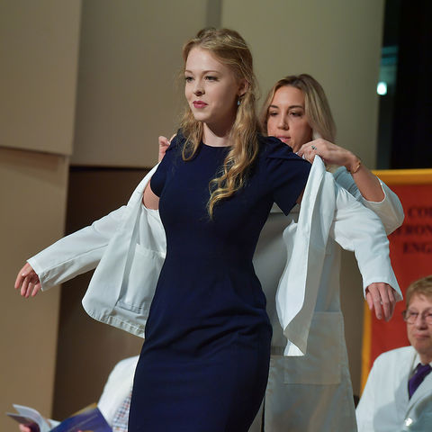 Student receives white coat in ceremony