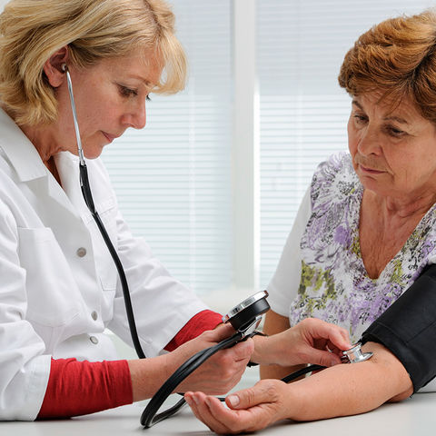 An Adult Gerontology Primary Care Nurse Practitioner takes a geriatric patient's blood pressure