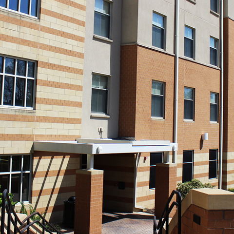 Outdoor view of Centennial Court D and entryway on a clear, sunny day