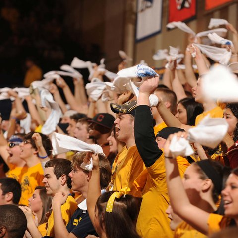 Golden Flashes basketball fans cheer on the team during a game at the MACC.