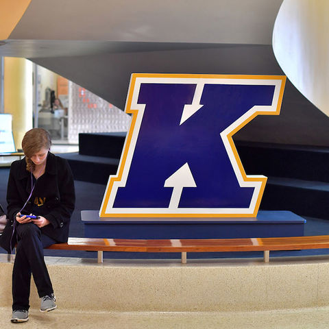 A student sits near the stairwell in the Kent Student Center
