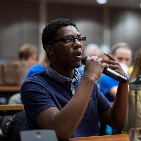 A CCI graduate student asks a speaker a question