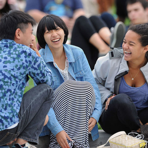 Students share a laugh during a concert on the Student Green.