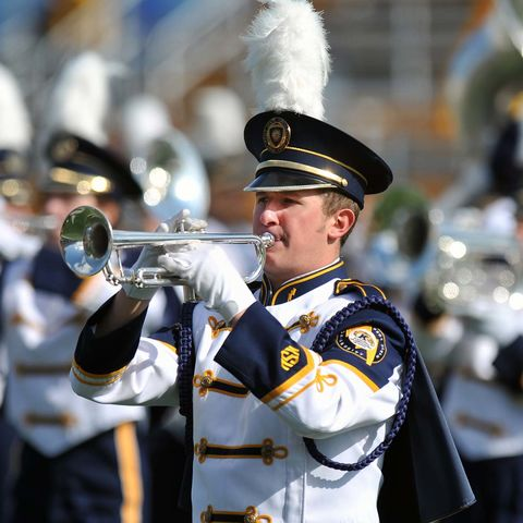 Members of the Kent State University marching band perform during half time at a football game.