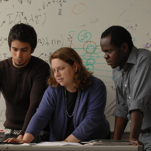 Dr. Robin Sellinger, center, works with international graduate students Wilder Iglesias (Venezuela) and Badel Mbanga (Cameroon) in her office at the Liquid Crystals Institute.
