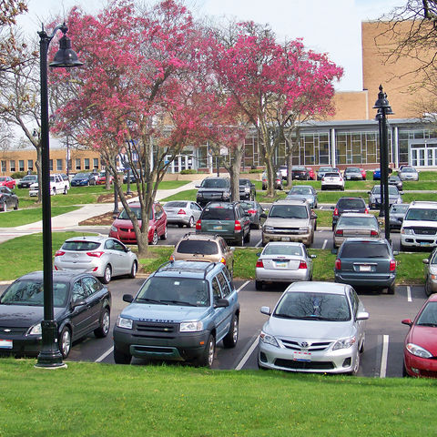 Cars line the parking lot behind the Music and Speech Center