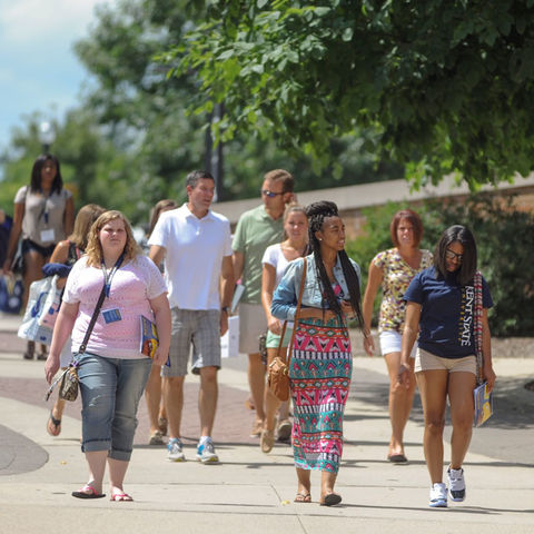 Incoming students in the Destination Kent State program make their way back to the student center during their visit to campus. All incoming freshman attend the program.