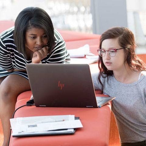 Two Kent State students working together on a project