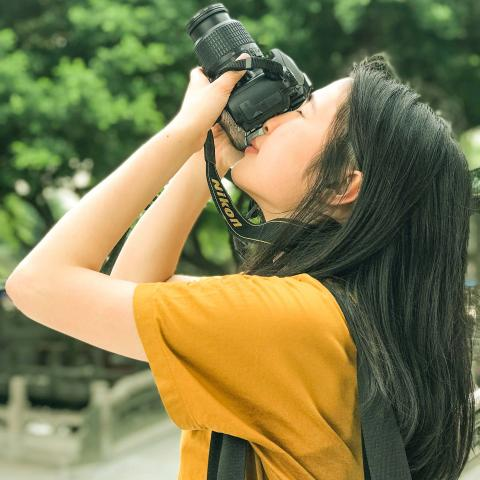 student borrowing camera
