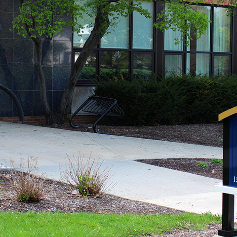 Outdoor view of Verder Hall and entryway with building sign on display