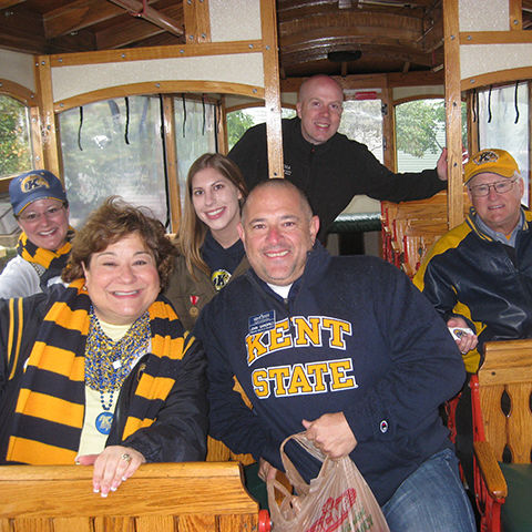 Alumni on Lolly the Trolley at Homecoming