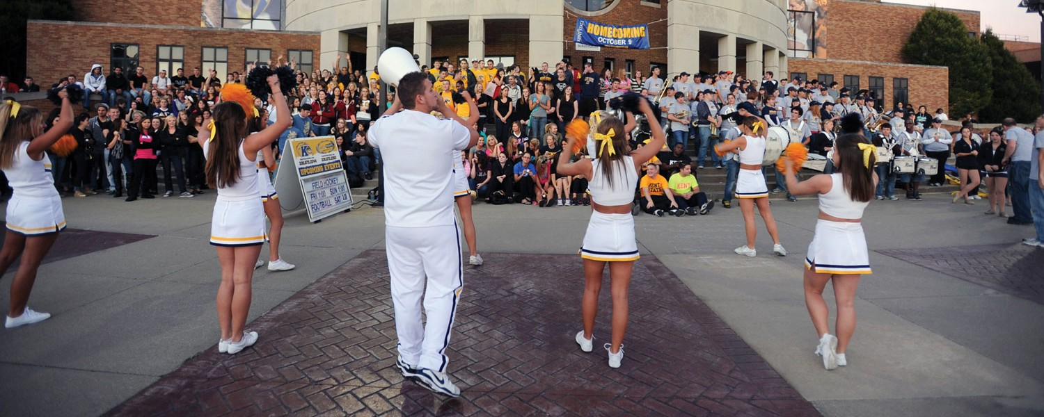 The Kent State cheerleaders lead a homecoming pep rally in front of the Memorial Athletic and Convocation Center.