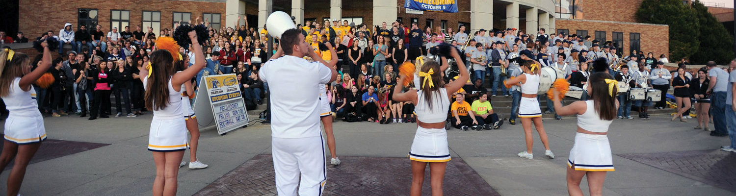 The Kent State cheerleaders lead a homecoming pep rally in front of the MACC on the thursday night before homecoming.