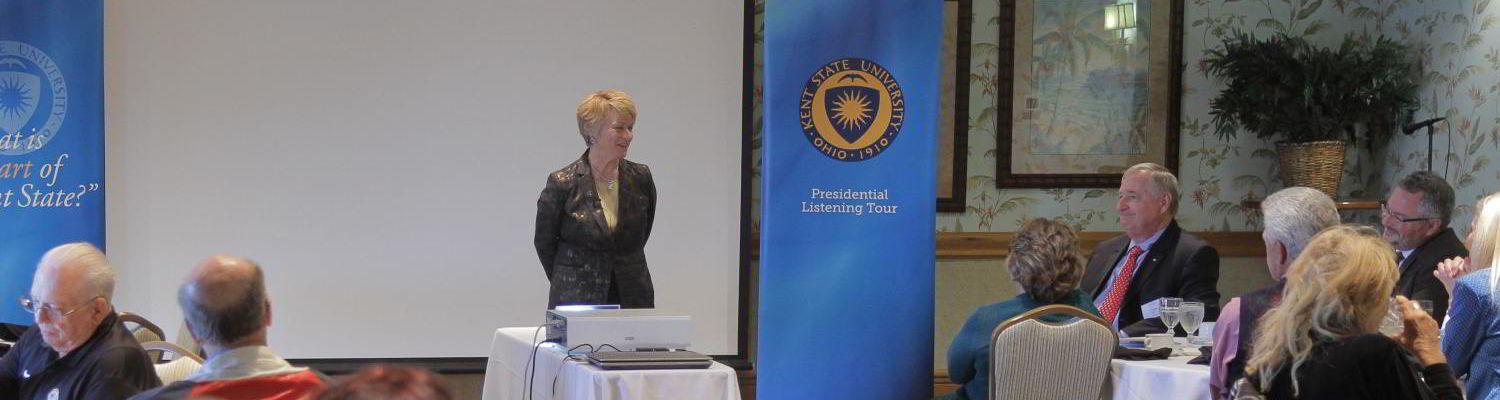 """President Beverly Warren listens as alumni share their thoughts about """"The Heart of Kent State"""" at the Central Florida Presidential Listening Tour event."""