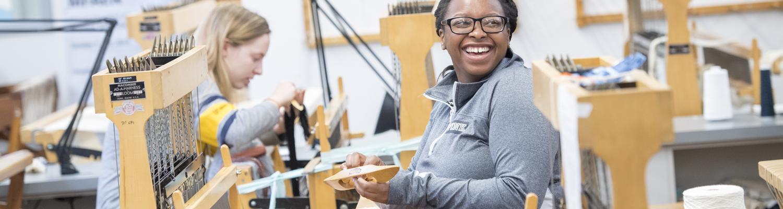 Undergraduate student weaving