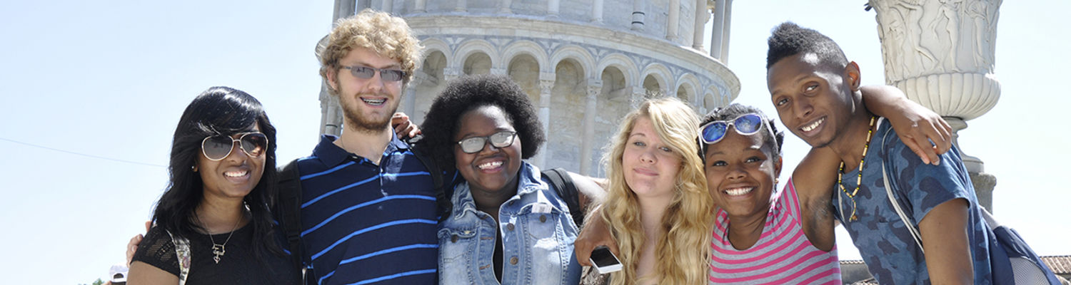 Students smiling for a picture abroad.