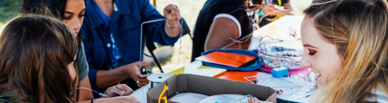 Kent Creativity Festival participants creating a wire community quilt