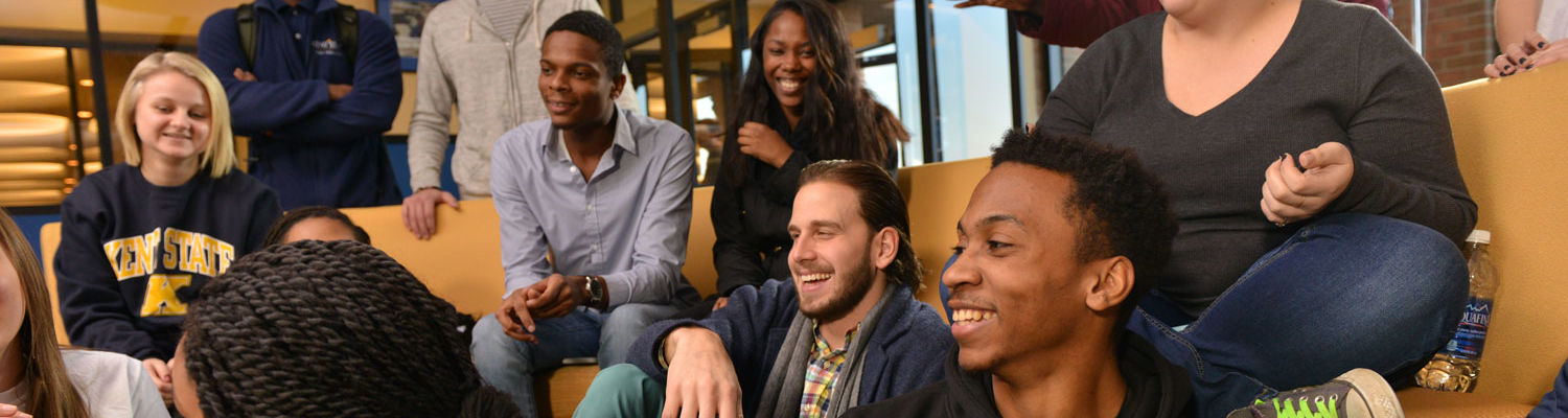 A group of students enjoy a laugh in the Student Center.