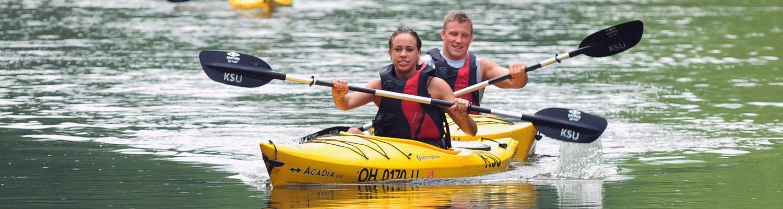 Students enjoy kayaking down the river.