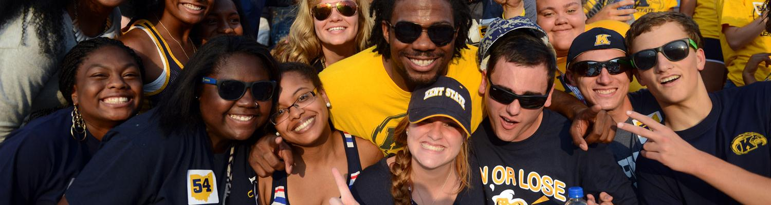 Students pose for photos with and without Flash, the mascot of Kent State sports during a home football game at Dix stadium.