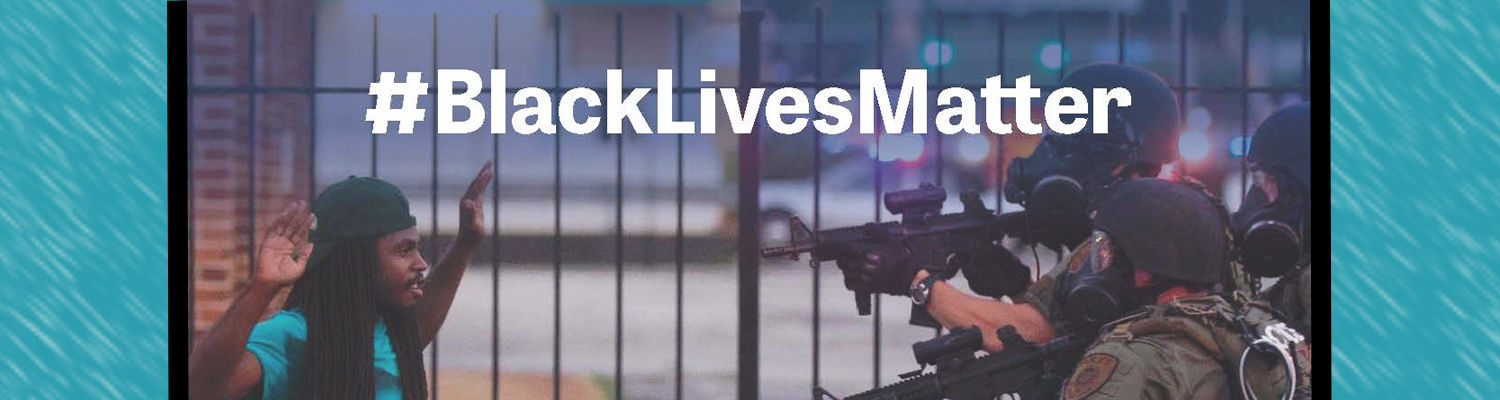 Image with text that reads #BlackLivesMatter. Image is of a young black male with his hands up and two police officers outfitted with military clothes, weapons, and protection.