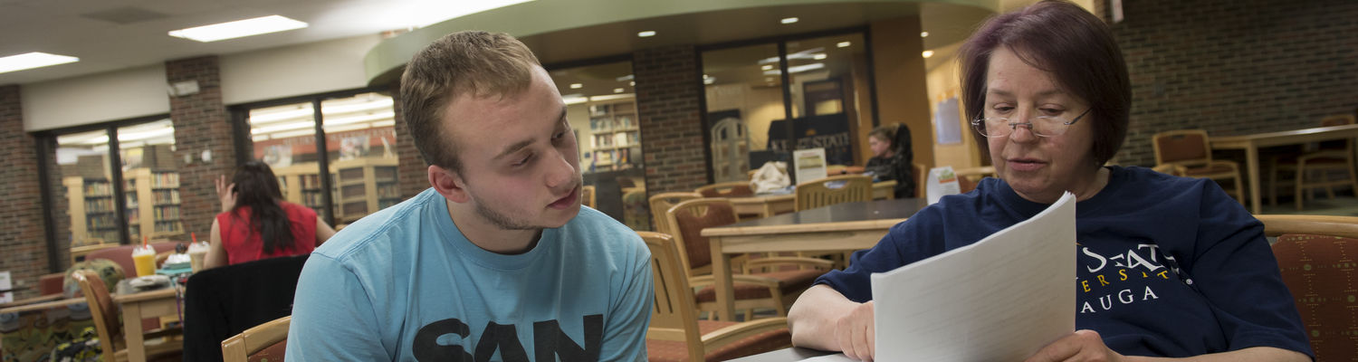 A student works with a mentor outside of class on the Geauga campus.