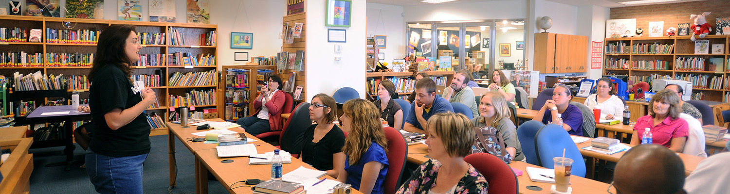 Local teachers present findings during a conference in the Reinberger Children's Library Center in the Kent State University Library.