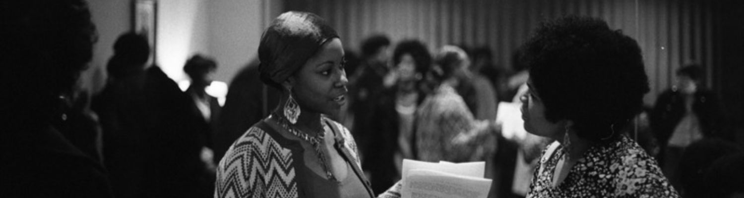 Two women are photographed having a conversation at a social gathering sponsored by Black United Students (BUS).1969.jpg