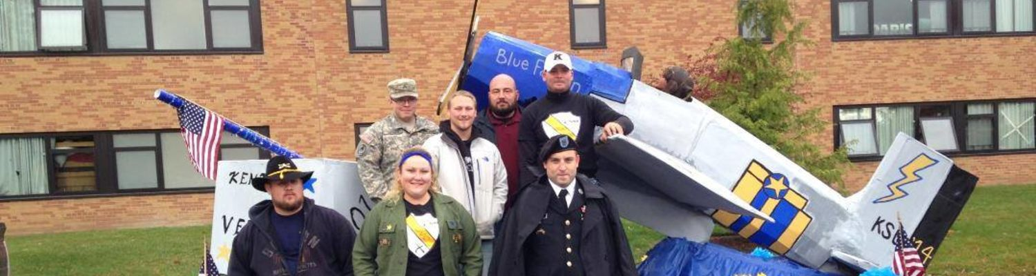 Students stand in front of the KSU Veterans Club Homecoming Float