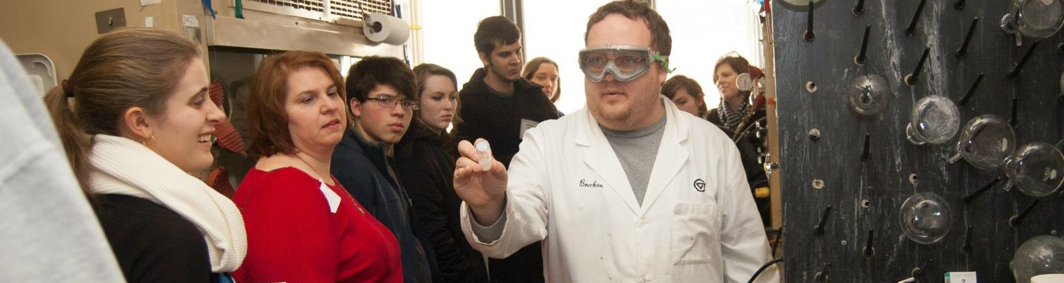 A graduate student displays his research for Explore Kent Chemistry Day attendees.