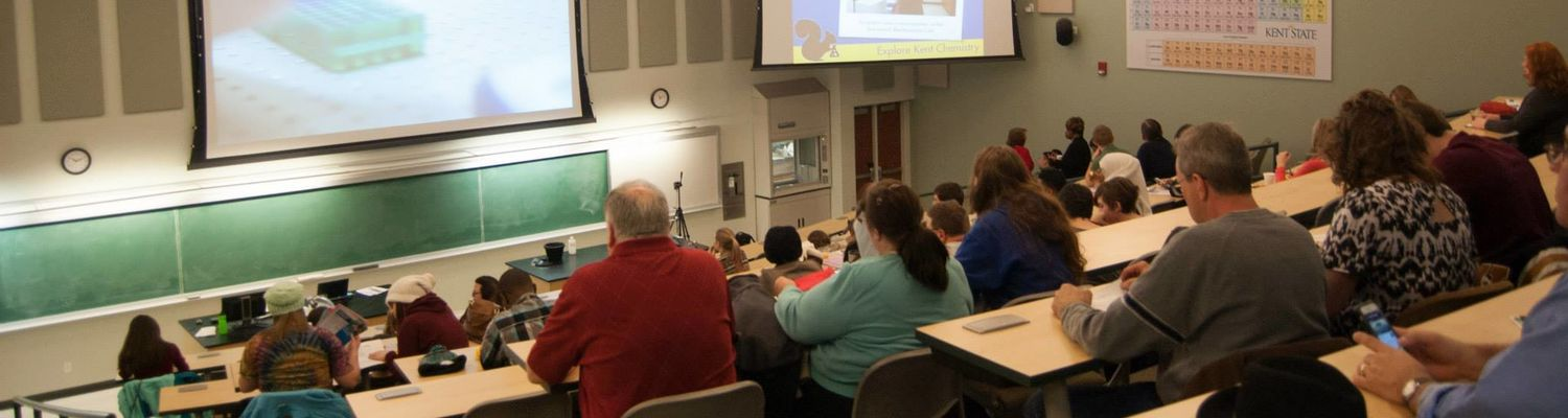 Attendees of the Explore Kent Chemistry Day gather in the large lecture hall.